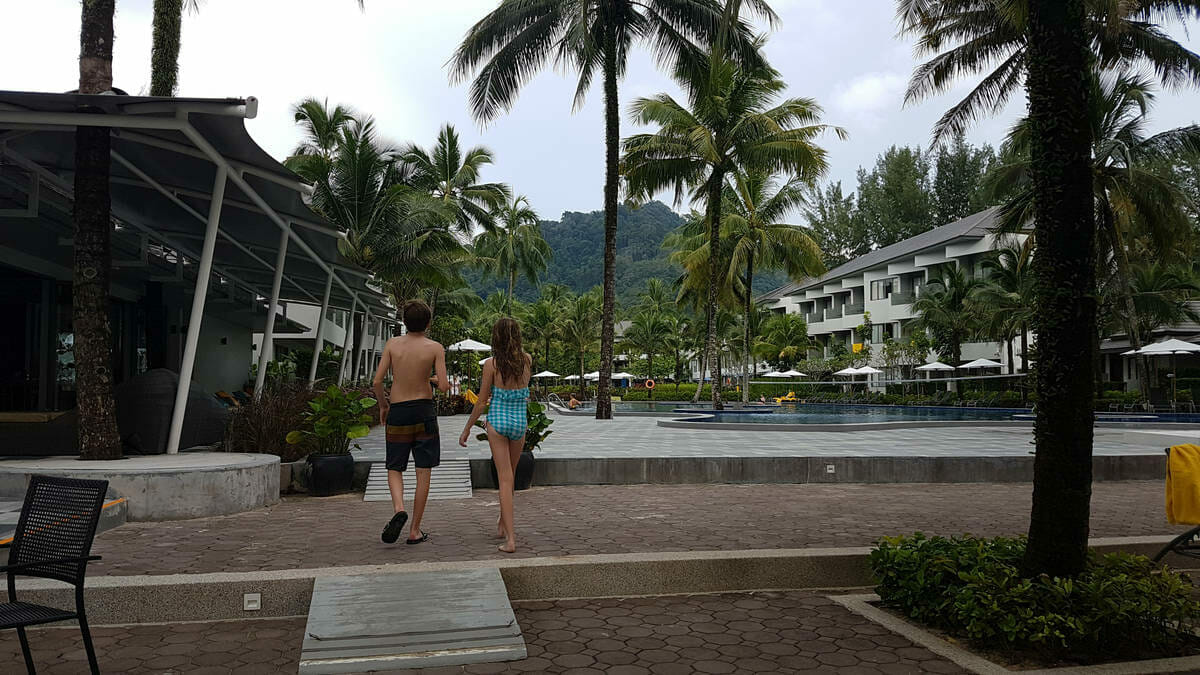 Kids walk towards the pool in a resort in Thailand