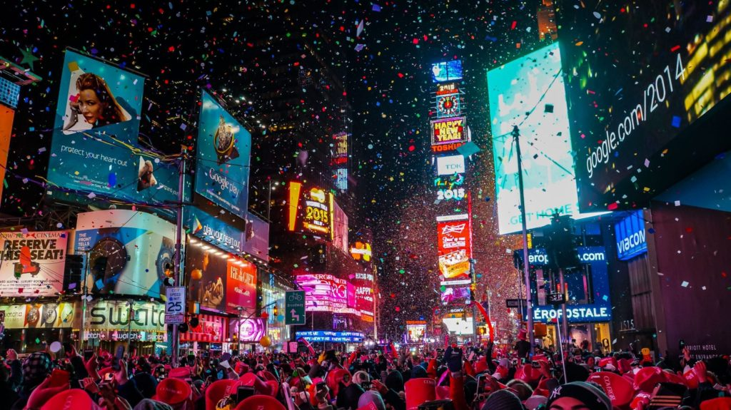 Times Square celebrates New Year with confetti and the ball dropping. Credit: Shutterstock