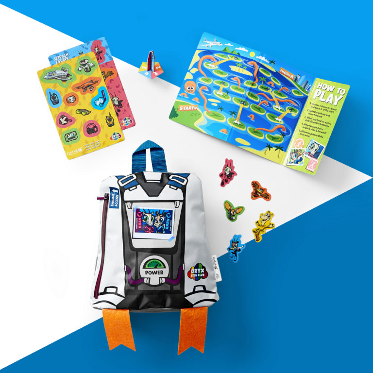 A backpack, stickers, treasure map and in-flight activity pack from Qatar Airways