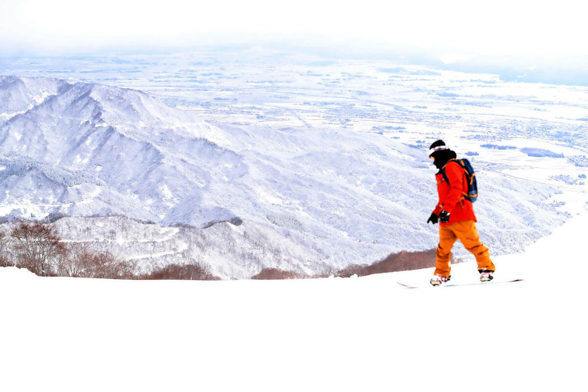 Lotte Arai Resort Japan view from top of mountain with skiier