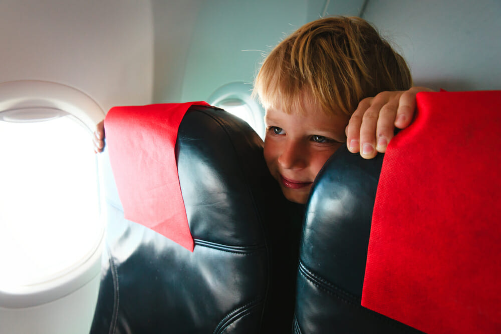 flying with kids plane Credit: Shutterstock