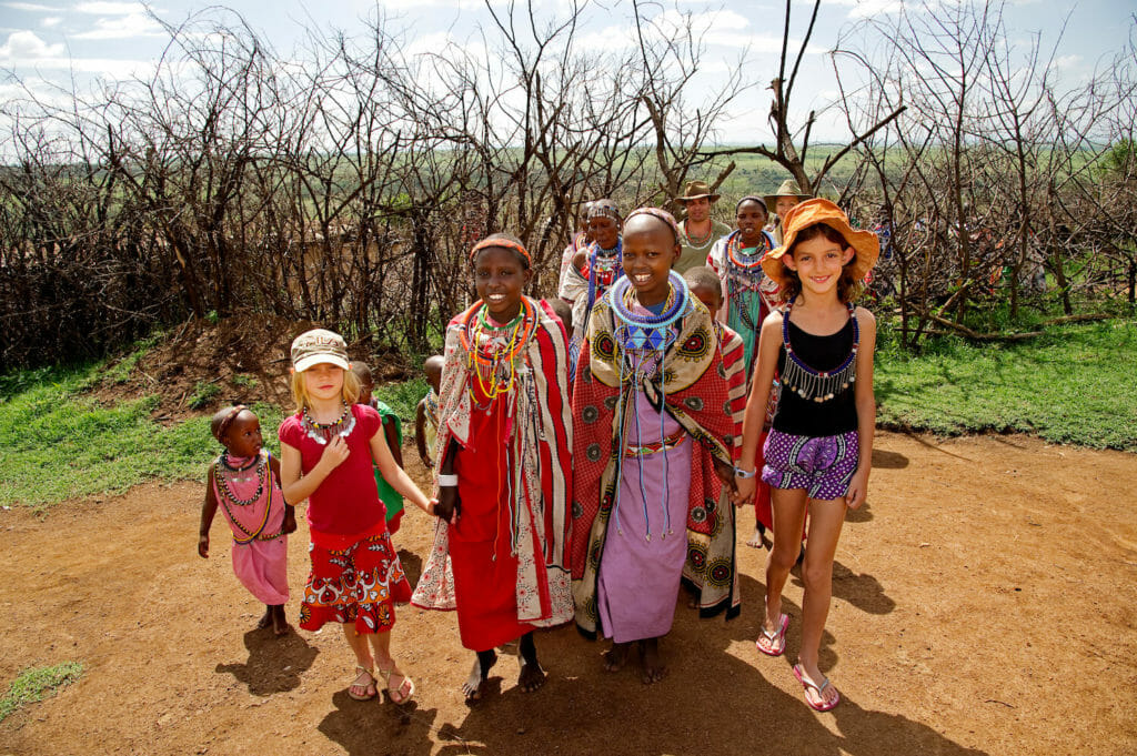 Young tourists meeting the local village children in Kenya, Africa