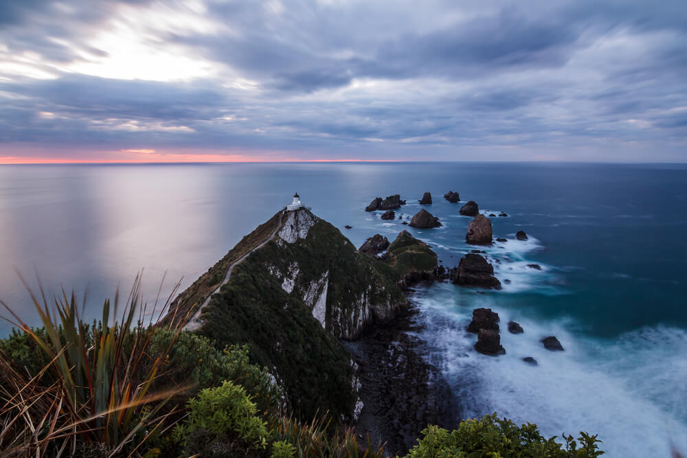 Scenery shot of sunrise at Nugget Point lighthouse