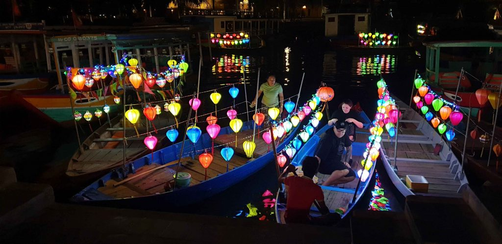 Boats decorated with lanterns in Hoi An Vietnam