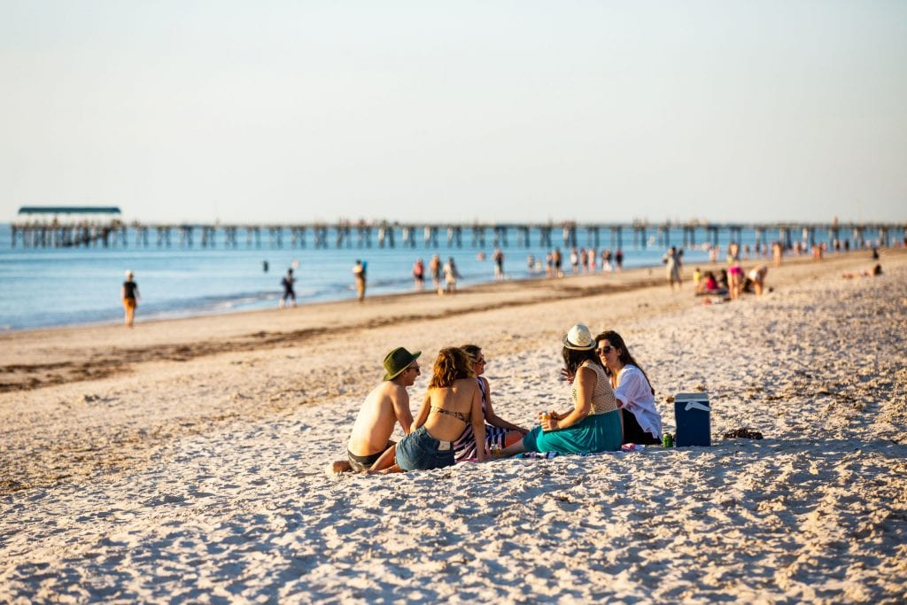 Picnics, swims, sport on the sand? Relax or get physical at Henley Beach. Credit: South Australian Tourism Commission/ Josie Withers