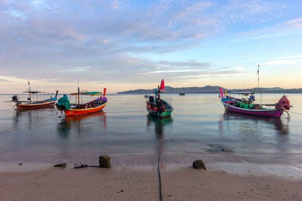 Fishing and long boats blend into the scenery at many Thai beaches Credit: Shutterstock