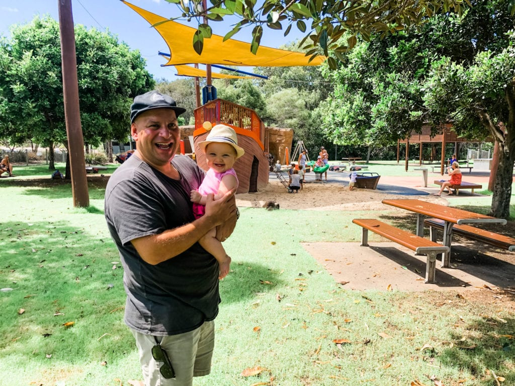 man and baby at Palm Beach parklands playground on the Gold Coast