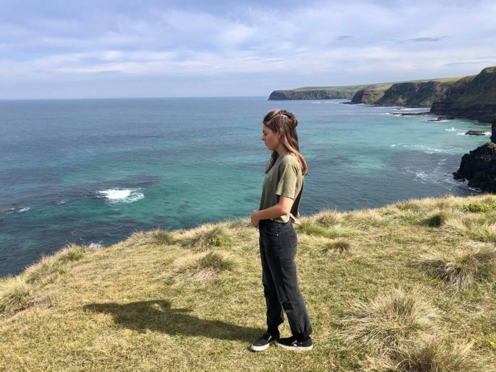 teen standing on cliff top in Victorian National Park