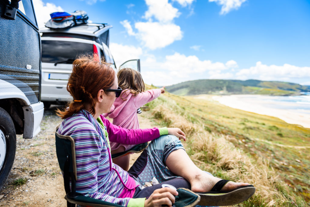 Motorhome RV or campervan is parked on a beach.