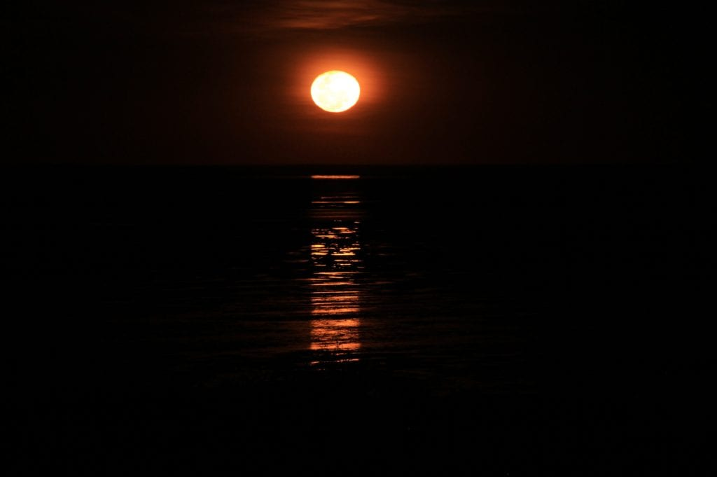 stairway to the moon, full moon light over low tide