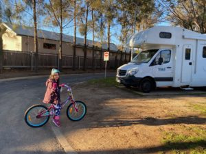Maui campervan with young girl on a bike